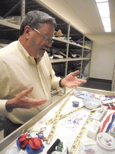 Don Rooney, director of exhibitions for the Atlanta History Center, displays some of the items in the Olympics collection.