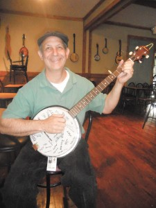 Steve Grossman plays a banjo signed by former co-workers at UPS.
