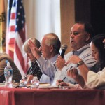 Left to right, city of Brookhaven opponents Chuck Konas, Jodi  Cobb and Jim Eyre listen to city proponents J. Max Davis, Glianny Fagundo and Stan Segal present their position during the July 9 forum.