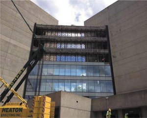 A contractor for Atlanta Public Schools removed three rows of glass from a sky bridge as part of renovations that will transform the former IBM campus into a new North Atlanta High.