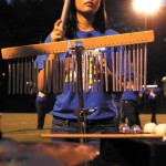 Erin Pitts, a percussionist in Chamblee's marching band, performs on the field.