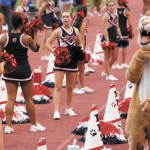 Dunwoody cheerleaders look for something to shout about as the school's mascot demonstrates its feelings.