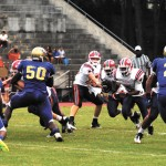 Chamblee's Bulldogs, in blue, came out on top 38-6 in their battle  with the Dunwoody Wildcats at Adams Stadium.