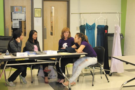 Athena's Warehouse board members Kim and Bee Nguyen, Cross Keys teacher Diane Gluck and student Brenda Khor, left to right, take part in a civic forum to promote the organization.