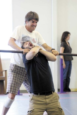 Chris Kayser, standing, and Joe Knezevich, front, practice hand-to-hand combat during a rehearsal of 'Metamorphoses.'