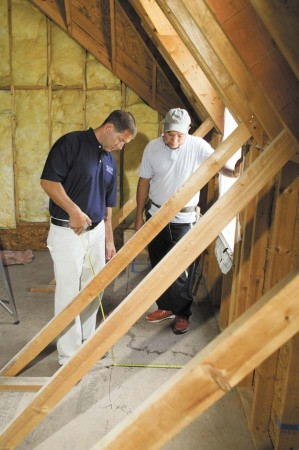 Randy Glazer, left, president of Glazer Design and Construction, discusses a bonus room project with Rolando Contreras at a residence in the Tiller Walk subdivision of Sandy Springs.