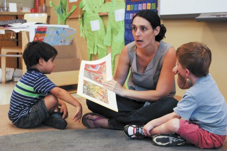 "From left, Nicholas Thompson, Madame Tiphaine Chauvel and Jacob Wolf go over a lesson in French  at the Atlanta International School's   Early Learning Center in Sandy Springs. Two years ago, the school began offering a ""full-immersion"" preschool program for 3 and 4 year olds, with all activities taught in German, Spanish or French. Phil Mosier"