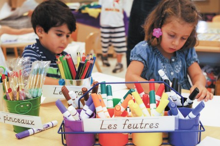 "Nicholas Thompson, left, and Antonella Pervanas enjoy preschool lessons taught exclusively in French at the Atlanta International School.  AIS says the program has been a ""phenomenal success."""