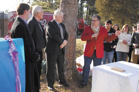 Cross Keys Foundation President Kim Gokce, in red jacket, introduces foundation members, Brookhaven city officials, Atlanta Braves Foundation members and the Briarwood Park Conservancy to the crowd.