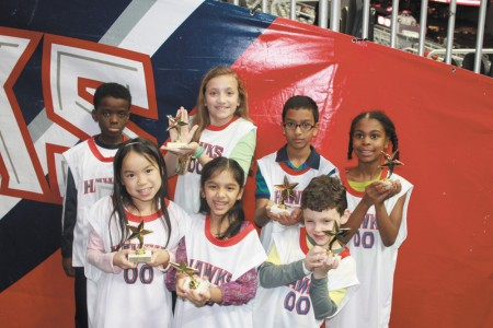 Sarah Smith Elementary School students were honored before a recent  Atlanta Hawks game for reading more than 1,000 minutes during a two-week period. Grade level winners were: Alaric Rodriguez, kindergarten; Anjini Naidu, first grade; Tuesday Blobaum, second grade; Lena Hoover, third grade; Ashley Redhead, fourth grade; and Tabitha Randklev, fifth grade.