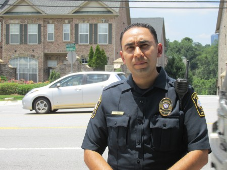 Officer Carlos Nino, at Buford Highway, says jaywalking incidents are down since Brookhaven became a city.