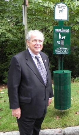 Buckhead Coalition president Sam Massell with pet waste station like the ones the coalition plans to install along the trail along Ga. 400.