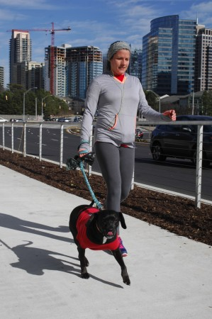 Buckhead resident Danielle Ingels and her dog Eva go for a walk along the PATH400 on Jan. 17.