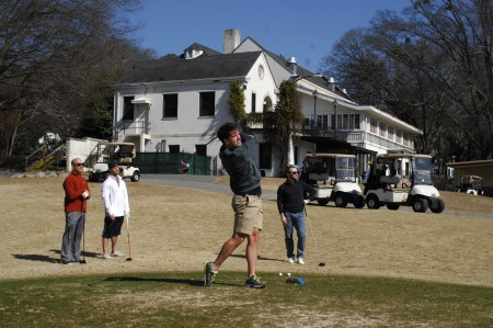 Cody Tomczyk, far left, with playing partner Randy Sieger, watch Bill Hunter, center, tee off at the Bobby Jones Golf Course on Feb. 14. The three, along with Donny Snyder, back right, took in a round at the Buckhead course named after the iconic Atlanta golfer.