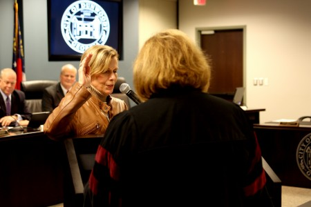 Dunwoody City Council member-elect Pam Tallmadge is sworn in to office by Judge Stacey Hydrick during the Nov. 9 City Council meeting. Tallmadge took her seat on the council immediately following her swearing-in.