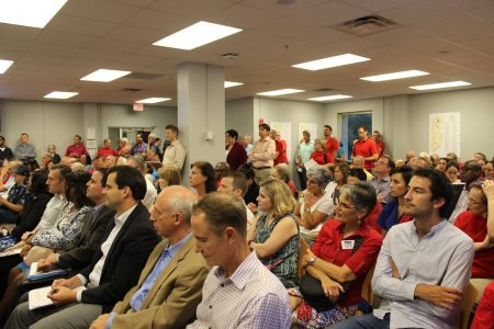 Many residents wore red shirts to the Sept. 7 Brookhaven Planning Commission to show opposition to the proposed MARTA transit oriented development. (Photo Dyana Bagby)