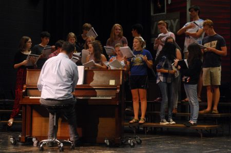 "Dunwoody High School Music Director Mark Lamback, at piano, leads the school's theater group through rehearsal of ""The 25th Annual Putnam County Spelling Bee"" on Sept. 8. (Photo Phil Mosier)"