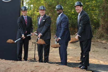 Tossing dirt for the ceremonial groundbreaking for the new Mercedes-Benz USA headquarters on Barfield Road are (from left) Dietmar Exler, MBUSA's president and CEO; Gov. Nathan Deal; Atlanta Mayor Kasim Reed; and Sandy Springs Mayor Rusty Paul. (Photo Phil Mosier)