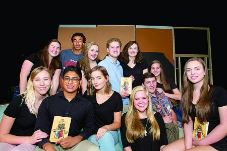 "Riverwood International Charter School Theater members pose with the ""Lend Me a Tenor"" script. (James Barker Photography)"