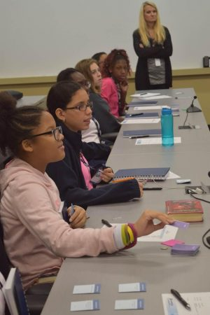 Students from Sandy Springs Charter Middle School learn about cyber security and career options in an Oct. 14 IBM career panel called CyberDay4Girls. (Photo Jaclyn Turner)