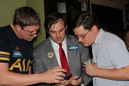 Meagan Hanson's strategist Robert Lee, far left, with campaign manager Ian Caraway, center, and her husband, David Hanson, watch results roll in on Election Night. (Photo Dyana Bagby)